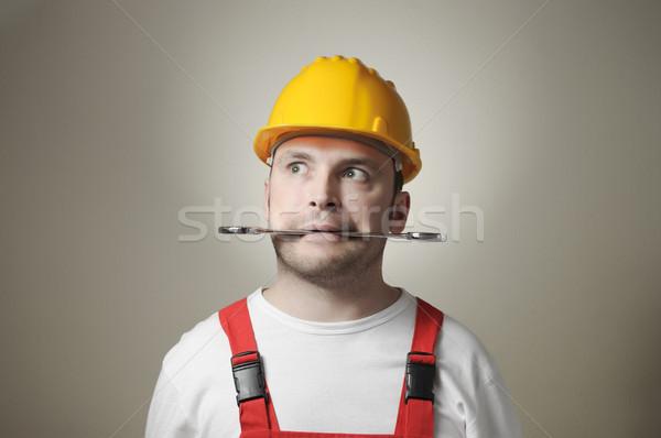 Foto stock: Louco · jovem · trabalhador · handyman · amarelo