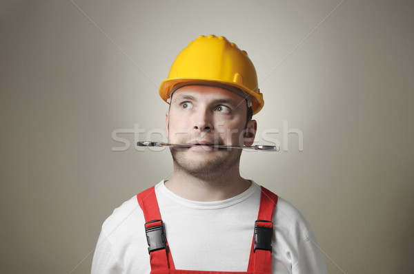 Louco jovem trabalhador handyman amarelo Foto stock © CsDeli