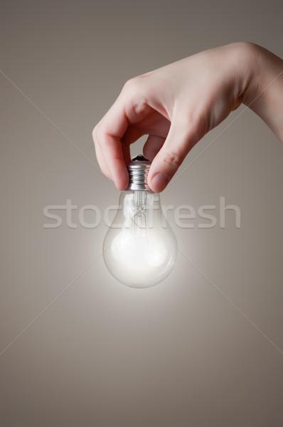 Kéz villanykörte tart izzó technológia üveg Stock fotó © CsDeli