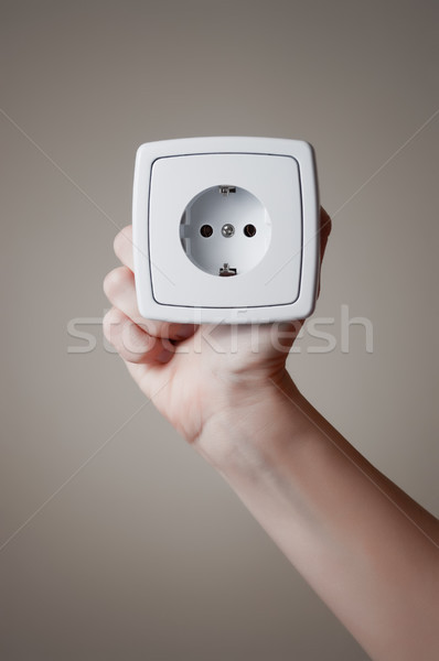 Hand with electric outlet Stock photo © CsDeli