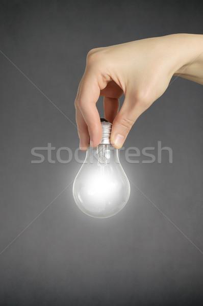 Kéz villanykörte tart izzó technológia energia Stock fotó © CsDeli