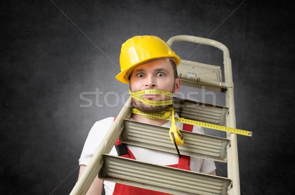 ügyetlen munkás mérőszalag építőmunkás létra épület Stock fotó © CsDeli