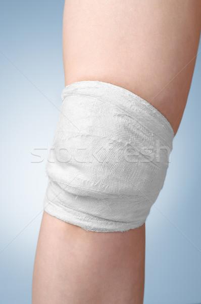 Injured female knee with bandage Stock photo © CsDeli