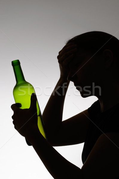 Silhouette of a sad drinker Stock photo © CsDeli
