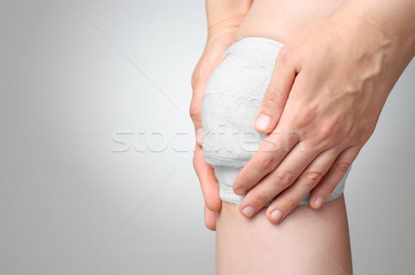 Ranny kolano bandaż bolesny biały strony Zdjęcia stock © CsDeli