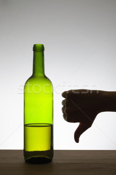 Thumbs down sign and a bottle of wine Stock photo © CsDeli