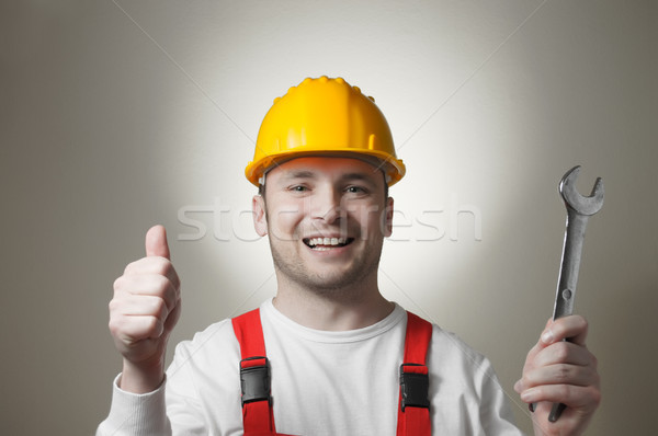 Smiling young worker with a wrench Stock photo © CsDeli