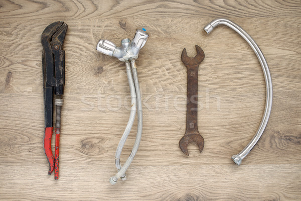 Old plumbing tools and tap on wooden background Stock photo © CsDeli