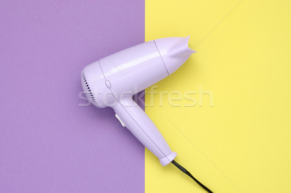Purple hair dryer on purple and yellow background Stock photo © CsDeli