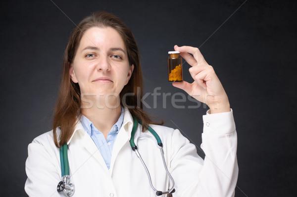 Orvos tart üveg gyógyszer női mutat Stock fotó © CsDeli