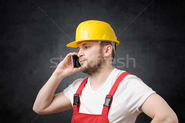 Construction worker using smartphone Stock photo © CsDeli