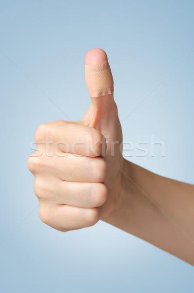 Tapasz női hüvelykujj tapadó bandázs kék Stock fotó © CsDeli