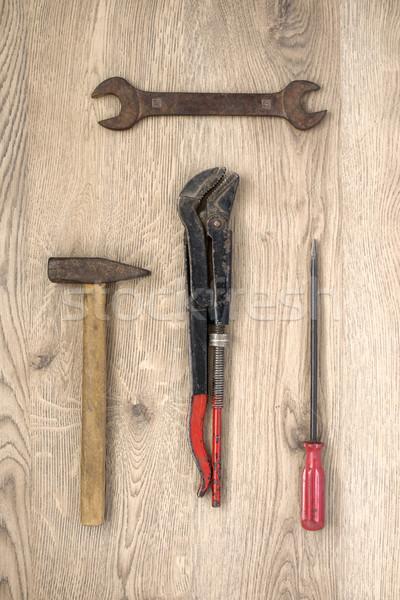 Old tools on wooden background Stock photo © CsDeli