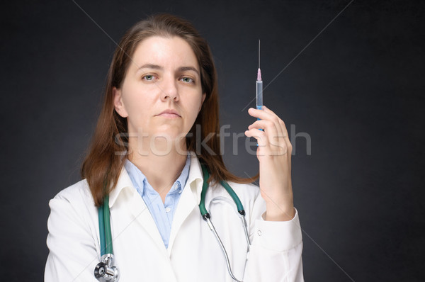 Female doctor with syringe Stock photo © CsDeli