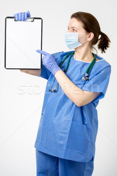 Orvos mutat vágólap női üres papír nő Stock fotó © CsDeli