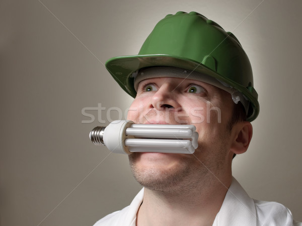 Engineer with Energy Saving Lightbulb Stock photo © CsDeli