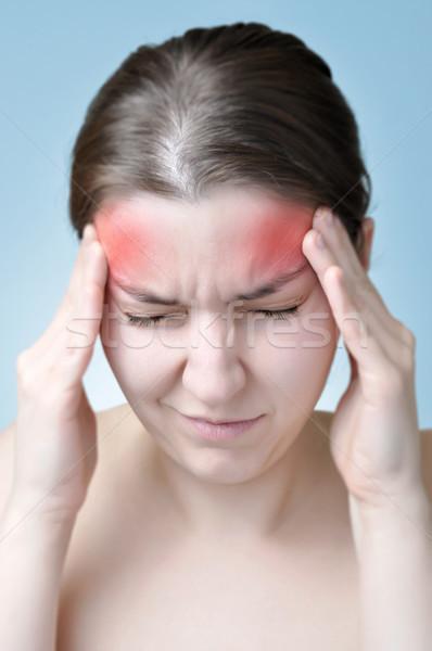 женщину страдание головная боль прикасаться голову Сток-фото © CsDeli