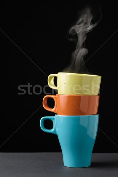 Három színes bögre gőz felső egy Stock fotó © CsDeli