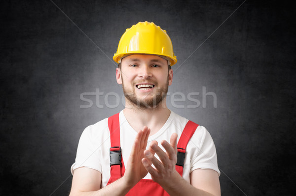 Construction worker clapping his hands Stock photo © CsDeli