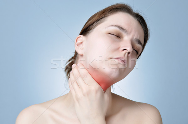 Nyaki fájdalom fiatal nő tart fájdalmas nyak nő Stock fotó © CsDeli