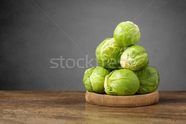 Fresh brussels sprouts on wooden table Stock photo © CsDeli