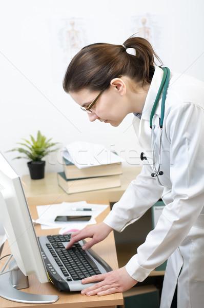 Doctor working on computer Stock photo © CsDeli