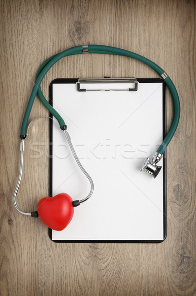 Clipboard with stethoscope and heart shape Stock photo © CsDeli