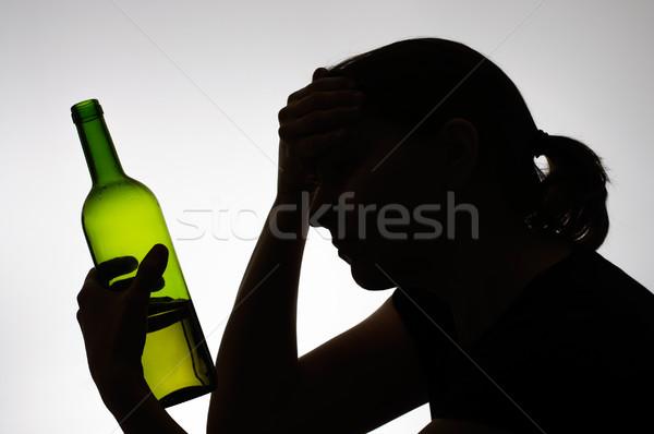 Sziluett nő tart üveg borosüveg lány Stock fotó © CsDeli