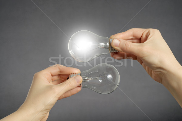 Decision making concept, hands with light bulbs. Stock photo © CsDeli