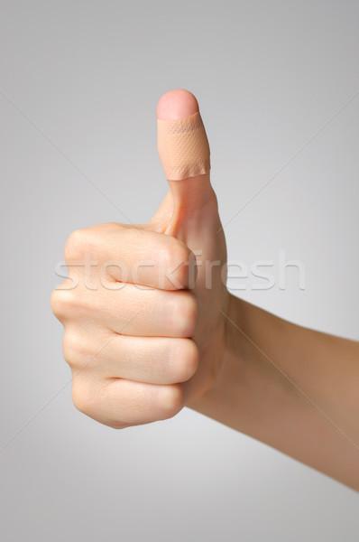 Stock photo: Plaster on female thumb