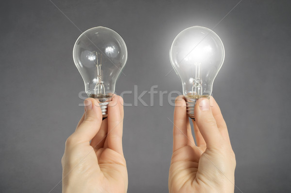 Decision making concept, hands with light bulbs Stock photo © CsDeli