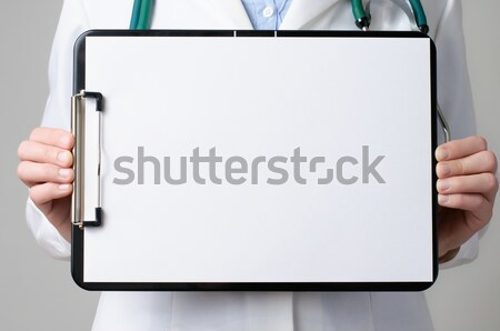 Doctor showing blank clipboard Stock photo © CsDeli