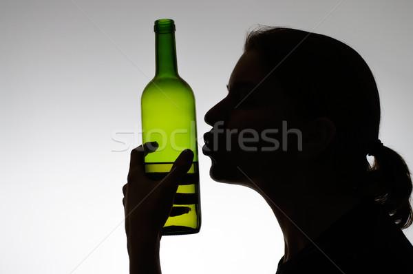 Nő csók borosüveg sziluett lány kéz Stock fotó © CsDeli