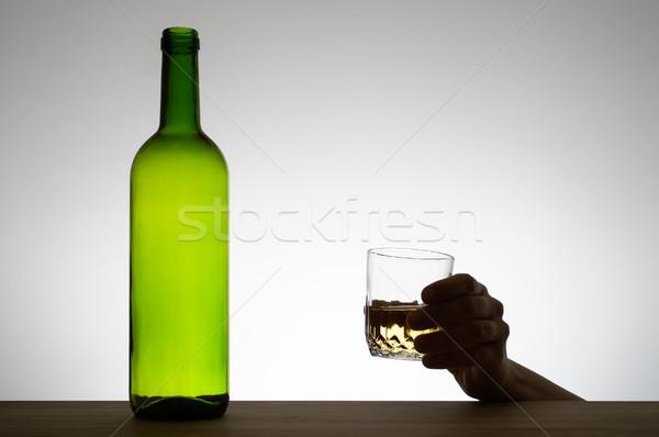 Kéz tart üveg bor sziluett asztal Stock fotó © CsDeli