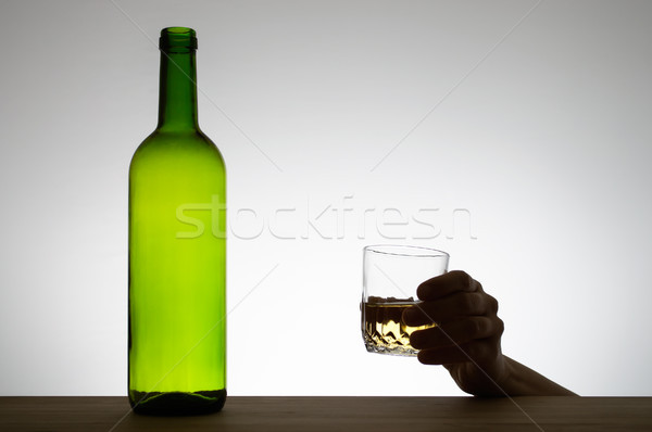 Hand holding a glass of wine Stock photo © CsDeli