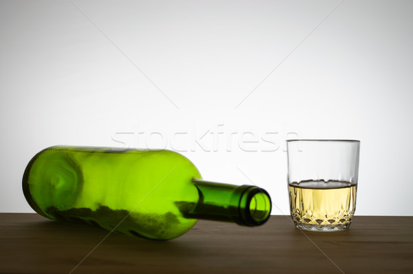 Wine bottle and a glass of wine on a table Stock photo © CsDeli