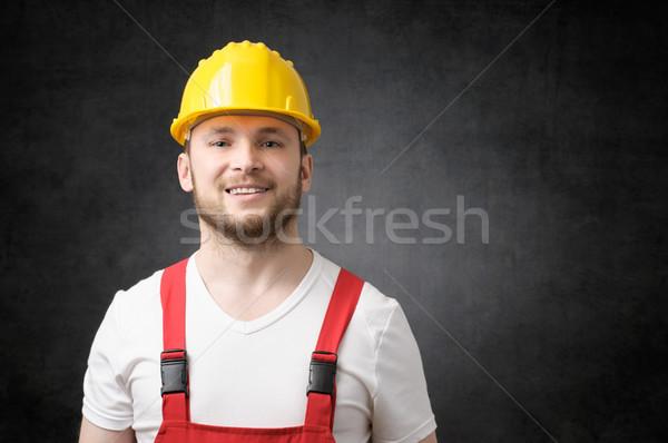Stock fotó: Boldog · munkás · mosolyog · citromsárga · védősisak · mosoly