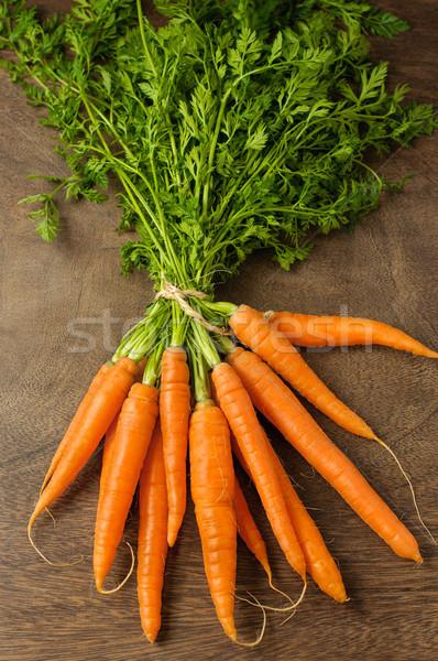 Fraîches carottes table en bois santé vert Photo stock © CsDeli