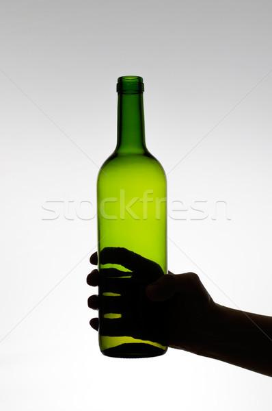 Női kéz tart üveg sziluett zöld Stock fotó © CsDeli