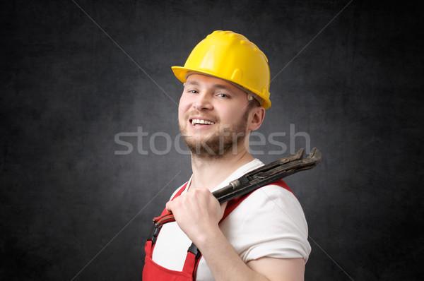 Boldog mosolyog vízvezetékszerelő cső franciakulcs férfi Stock fotó © CsDeli