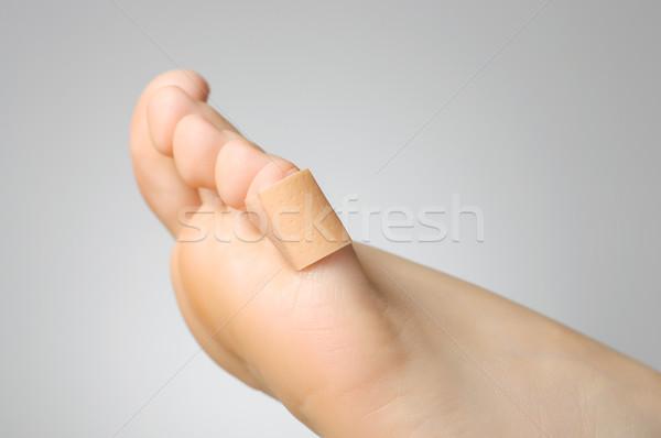 Gips vrouwelijke teen gewond zelfklevend Stockfoto © CsDeli