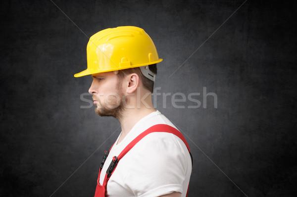 Frustré travailleur de la construction vue de côté triste jaune Photo stock © CsDeli