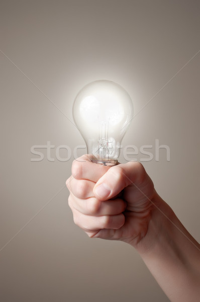Hand with light bulb Stock photo © CsDeli