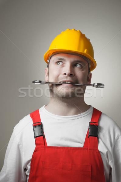 őrült fiatal munkás ezermester citromsárga védősisak Stock fotó © CsDeli