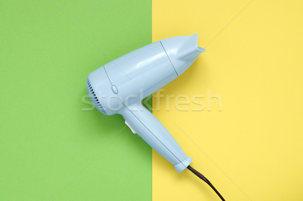 Blue hair dryer on green and yellow background Stock photo © CsDeli
