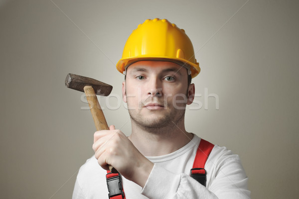 Young worker with hammer Stock photo © CsDeli