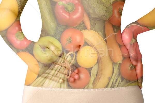 A woman's abdomen with fruits and vegetables isolated on white Stock photo © CsDeli