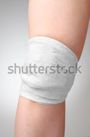 Ranny kolano krwawy bandaż kobieta krwi Zdjęcia stock © CsDeli
