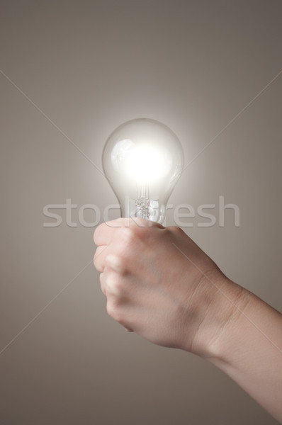 Hand with light bulb Stock photo © CsDeli