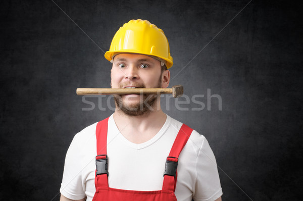Insane construction worker Stock photo © CsDeli